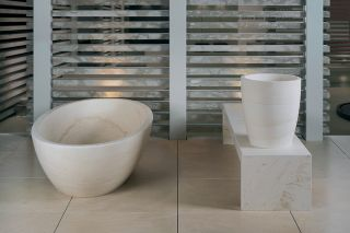 Caved stone bath, in solid marble or in three rings